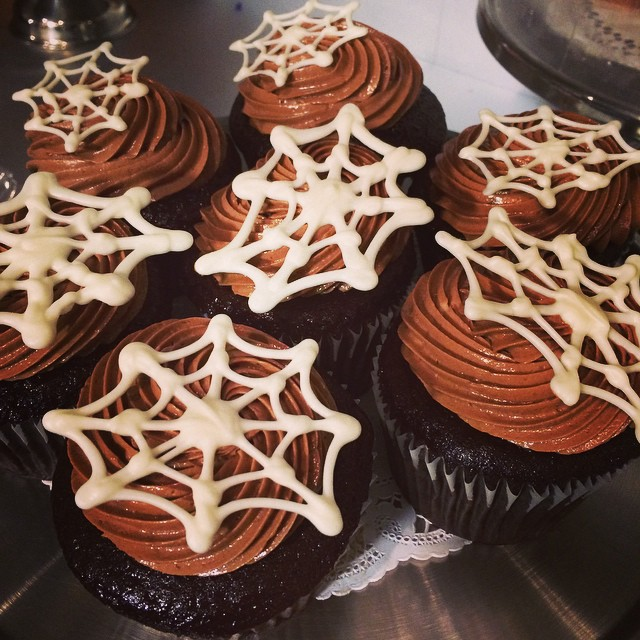 DOUBLE CHOCOLATE CUPCAKES TOPPED w/ WHITE CHOCOLATE SPIDER-WEBS:: *Available NOW in the Bakery