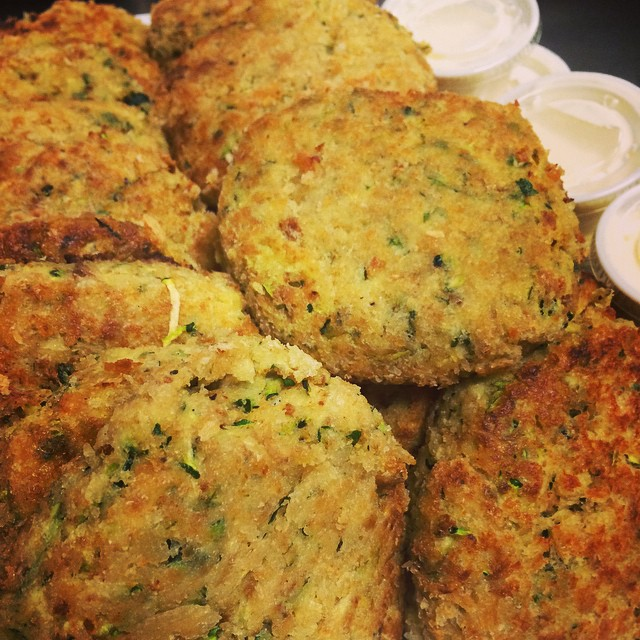 ZUCCHINI + RICOTTA FRITTERS served w/ Lemon Parmesan Sauce:: *Available NOW in the Take Away Market